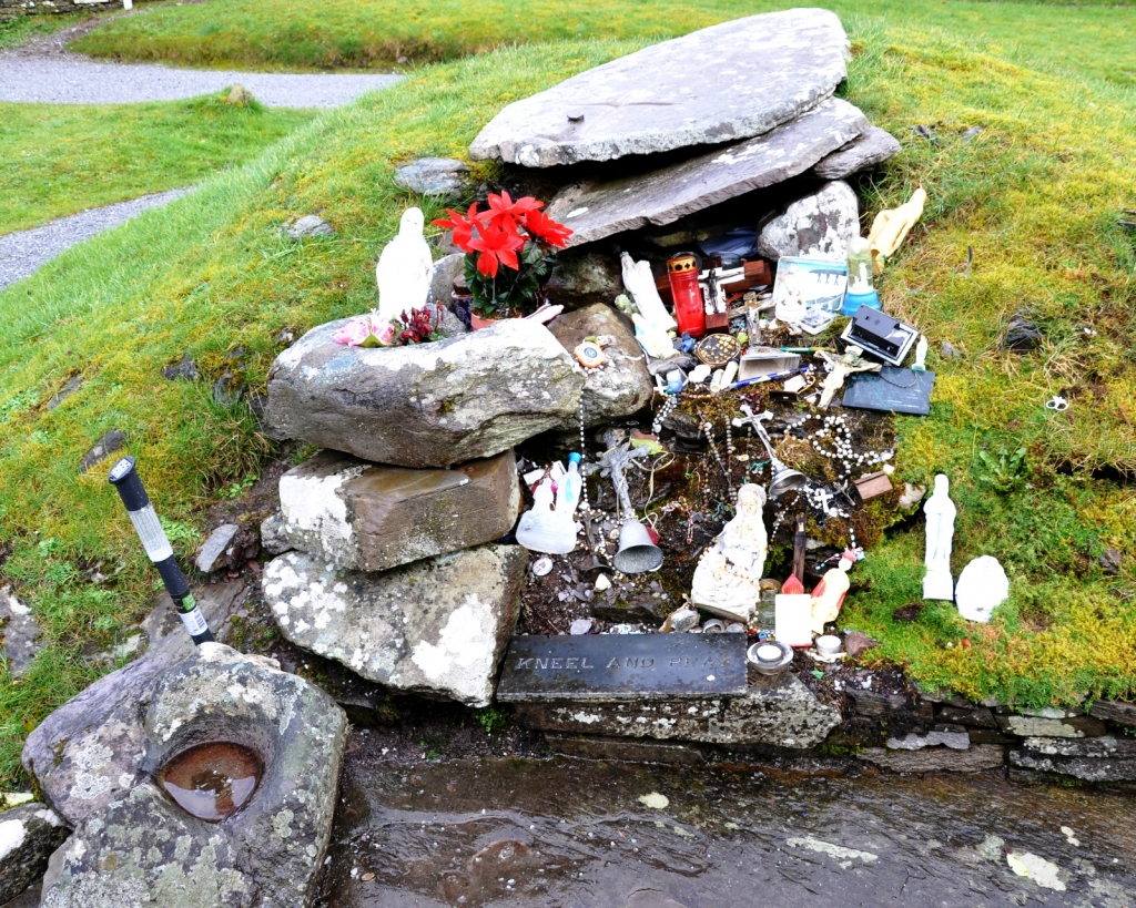The grave of St Gobnait which is a focus of devotional activity. It is a station on the rounds and people frequently leave votive offerings here. 