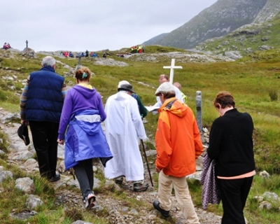 Mman, Connemara: Pilgrims, led by the cross, complete the Stations on the traditional August pilgrimage day.  