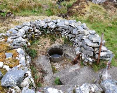 The Well is located on western side of the City. It is the last station on the pattern. It is enclosed by a stone wall with a small amount of votive offerings present. 