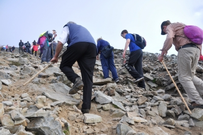 Pilgrims climbing Casán Phádraig, the path leading up the Reek proper, early in the morning.