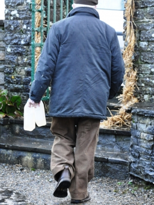 A man taking away well water from St Brigid's holy well Liscannor on 1 Feb 2013, St Brigid's Day