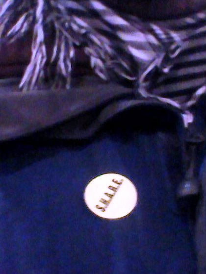The SHARE sticker, found on every coat for Cork people, leading up to Christmas.