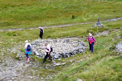 Pilgrims circling on of the leacht at the site. They throw a stone into the centre after completing their rotations.