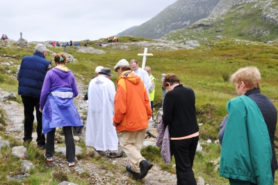 The cross leads the pilgrims around the site, with prayers, reading and singing at each station.